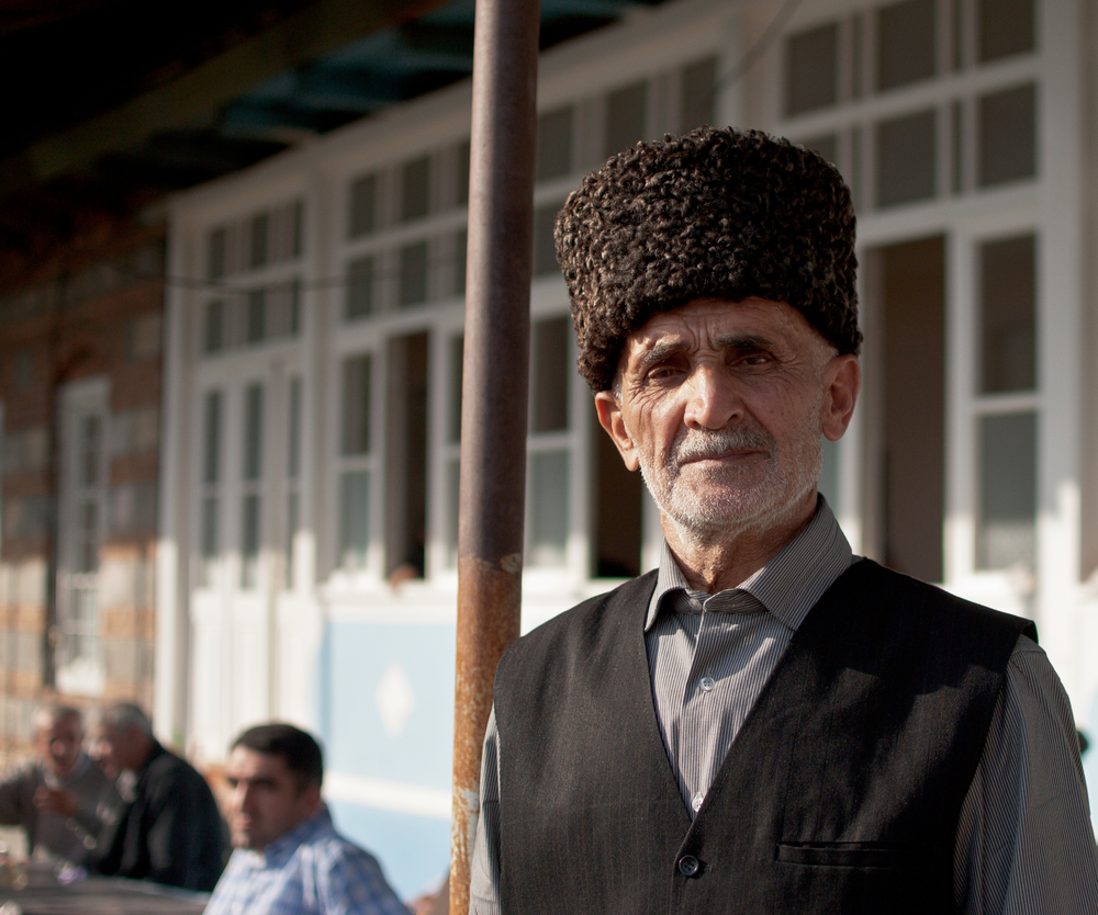 A villager from Kish, wearing a traditional Caucasian hat at a wedding.