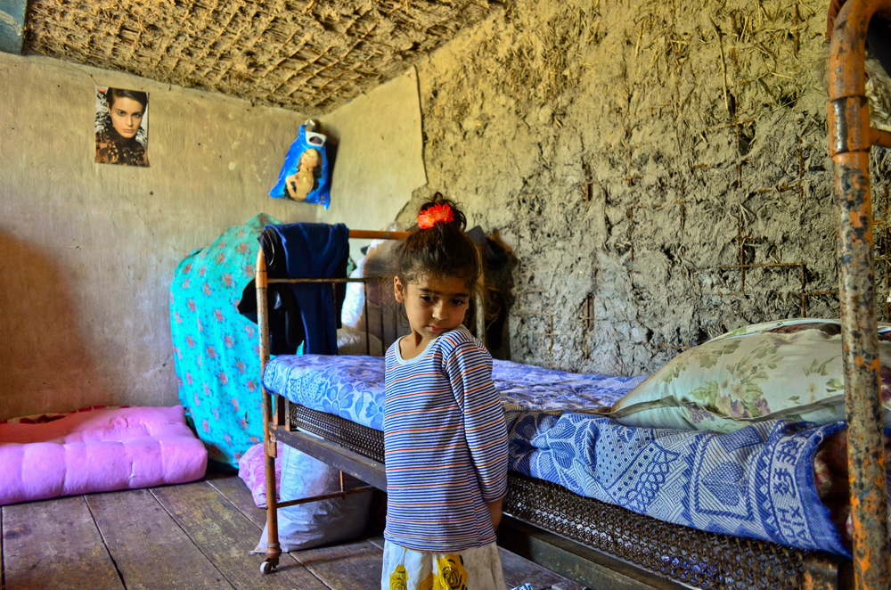 Guliser Memmedova, her daughters and grandchildren continue to occupy a derelict hut in the Urajaly village. Well over a year after the floods, they share this dilapidated one-room shack.