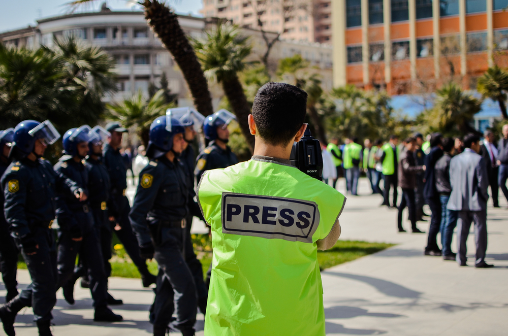 Journalists recording a show of force by the government on a day of protests organized by the opposition in Baku, Azerbaijan.