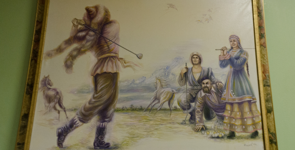 An excellent golfing painting in the office of the Moskovsky Komsomolets newspaper.