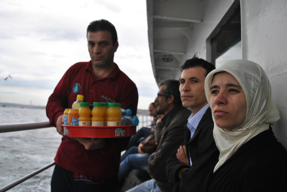 Passengers on a ferry in Istanbul.