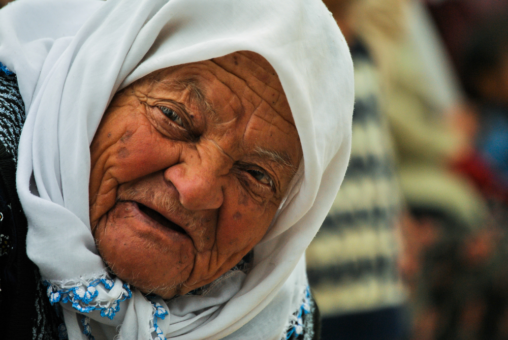 An older woman comes to see her grandchildren perform in a school play in the Turkish village of Gebecheler on Ataturk Day.