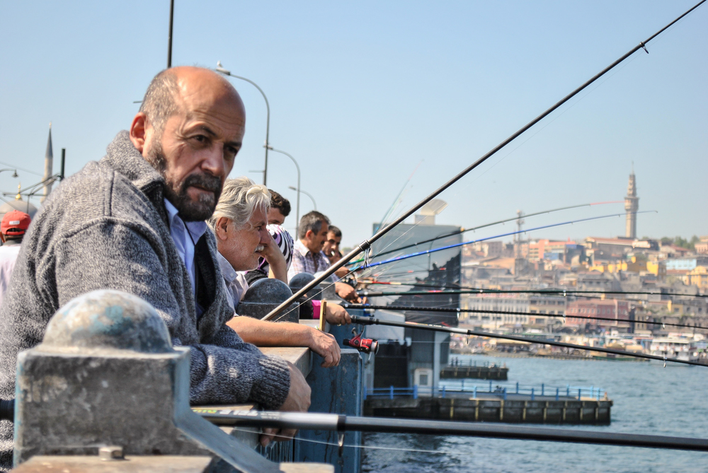 Fishermen on the Galata bridge in Istanbul, Turkey.