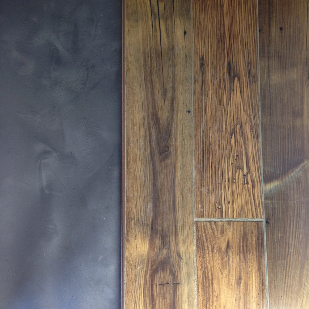 We laid down a subfloor first then we put down these great wood floors. They are actually laminate but they look like old reclaimed wood.