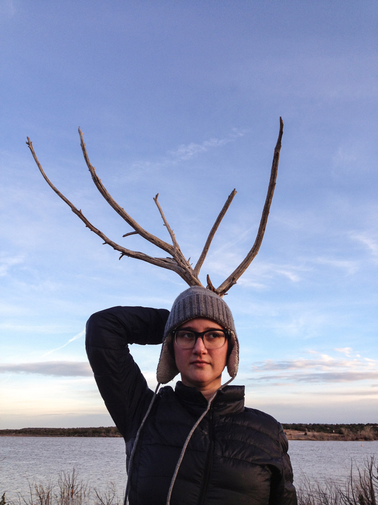 Sarah at the lake, with antlers.