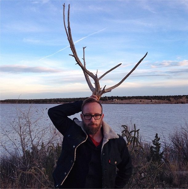 Eric at the lake, with antlers