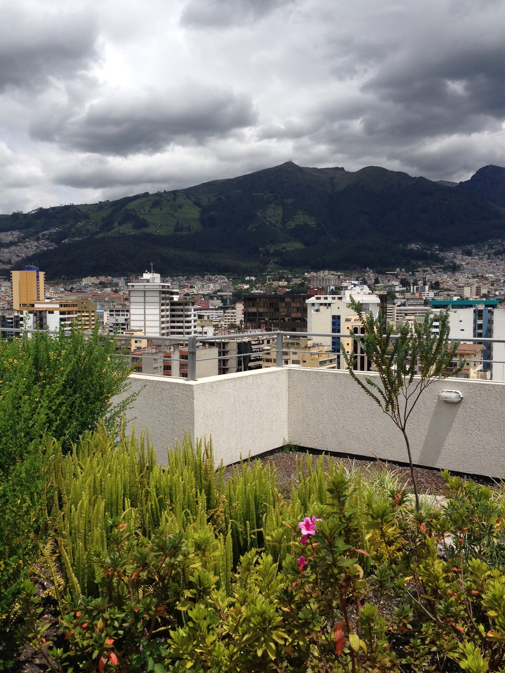 exploring the terrace of the building - looking over Quito.