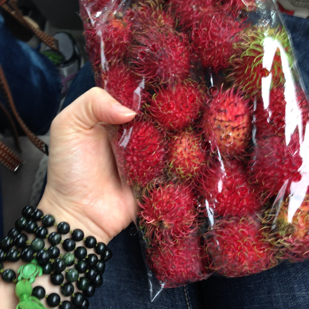 Rambotan. The best fruit to hold in your hand ever! The outside is soft and feels a little like rubber, very much like a lychee.