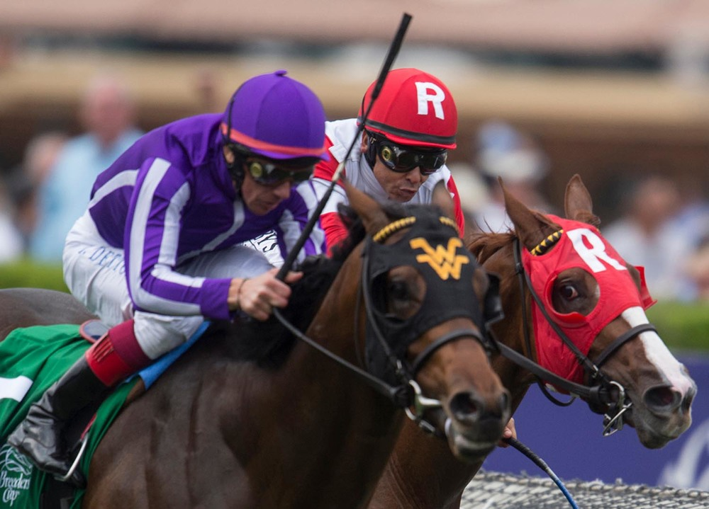 Heading to the finish line Mike Smith, right, pushes Luck of the Kitten against Hootenanny with Lanfranco Doyle during the Breeders' Cup Juvenile Turf 6th race of the Breeders Cup World Championships at Santa Anita Park in Arcadia on Friday. Hootenanny with Lanfranco Doyle wins the race.