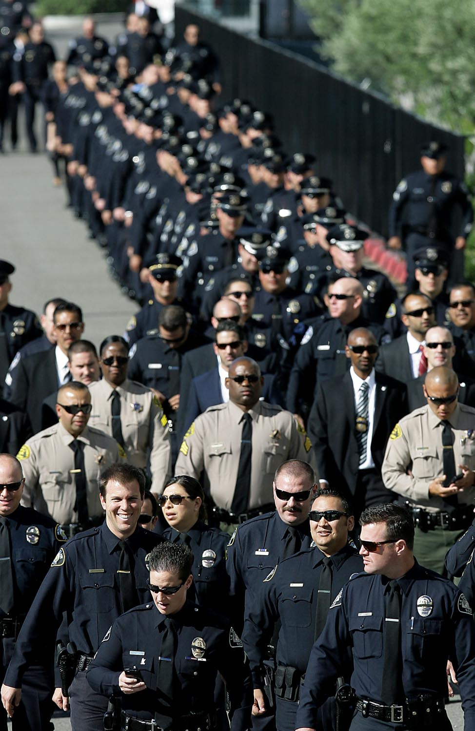Thousands of emergency personnel arrive for services for Pomona police officer Shaun Diamond at Citizens Business Bank Arena Thursday in Ontario, CA. November 6, 2014.