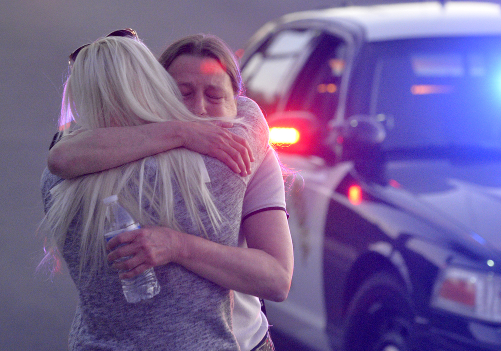 Emilie Gleisberg, left, hugs her mother Diane Kimble, right, as family members reunite at The Rock Church after at least 14 people were killed and 17 others injured by as many as three shooters at the Inland Regional Center in San Bernardino, CA. Wednesday December 2, 2015. Kimble was in the building at the time of the shooting.