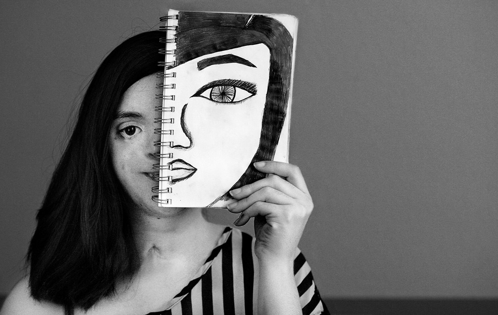 Lisa Encinas, 25, of Moreno Valley loves to draw with pencils and work with pastels in her art work, she is pictured with one of her many drawings on a sketch pad Tuesday in Moreno Valley, July 14, 2015. 