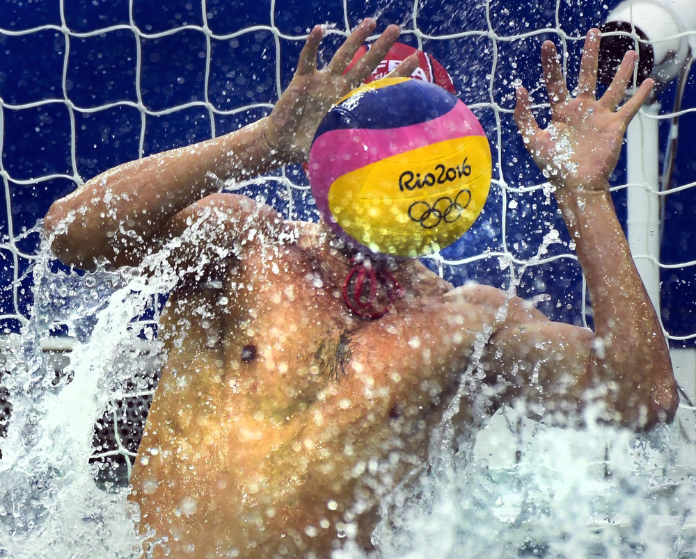 THE RINGS OF RIOAug 10, 2016; Rio de Janeiro, Brazil; United States goalkeeper Merrill Moses blocks a shot on goal by France in a preliminary round Group B Water Polo match at Maria Lenk Aquatics Centre during the Rio 2016 Summer Olympic Games.
