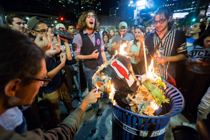 Students burn a Donald Trump piñata as part of a spontaneous protest that erupted on campus on Nov. 8, 2017, after Trump won the presidency. By the time the protest reached Westwood Village, at least 2,000 students had joined, according to LAPD.