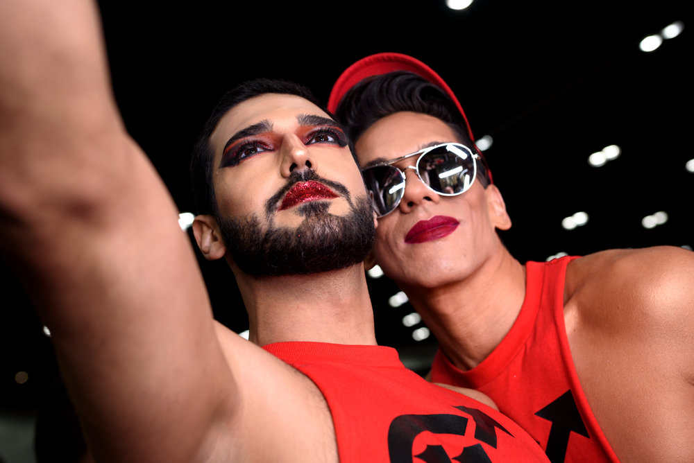 People take a selfie during RuPaul's DragCon at the Los Angeles
