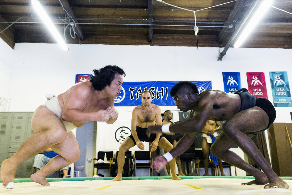 Takeshi Amitani, of Japan, and Compton native Phillip Barnes also known as Monster, charge each other during a sumo wrestling practice in Carson Saturday, May 5, 2018. Amitani coaches and trains with Monster as the two will enter the same weight class this year for the US Sumo Open. Amitani is a 5-time Japanese National University Champion, he also was the undefeated Openweight champion in the  US Sumo Open last year. This will be Monster's second sumo competition.