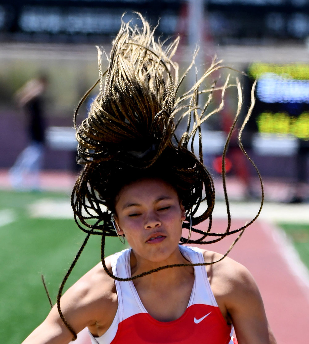 Mater Dei's Jade McDonald competes in the long jump during the CIF-SS Track and Field Masters meet at El Camino College in Torrance, Calif., on Saturday, May 26, 2018.