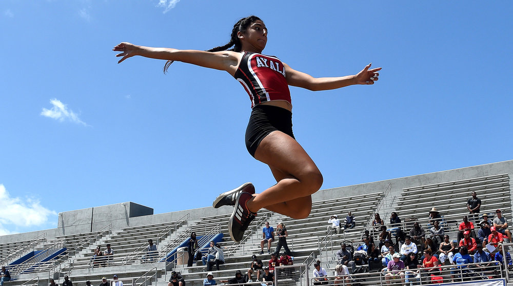 Aya;s's Anyssa Romo competes in the long jump during the CIF-SS Track and Field Masters meet at El Camino College in Torrance, Calif., on Saturday, May 26, 2018.