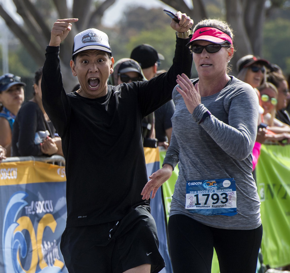 Personal pacer Rhodri Lumba wants to focus attention on his client, Danielle Heath, who beat her first marathon time by more than one hour in Costa Mesa on Sunday, May  6, 2018.
