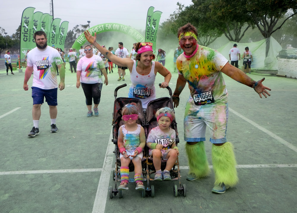 Runners pose for photos in the Color Run at the StubHub Center in Los Angeles, United States, June 23, 2018.