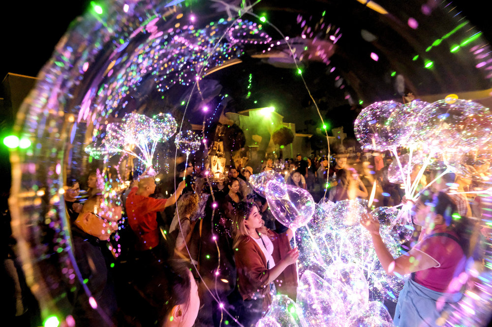 Vendors sell LED lights balloons at the '626 Night Market' on July 1, 2018 in Arcadia, California, the United States. 626 Night Market is an event that attracts all generations of the Chinese American community and showcases many Los Angeles food vendors.