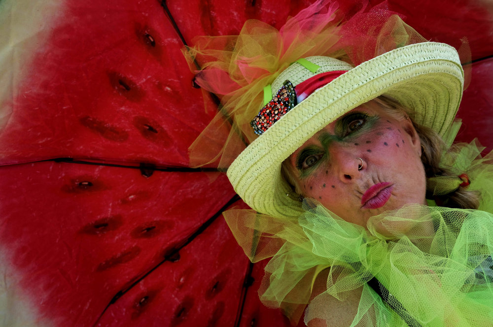 A woman dresses up and poses for photos at the 56th Annual California Watermelon Festival in Los Angeles, Saturday, July 28, 2018.