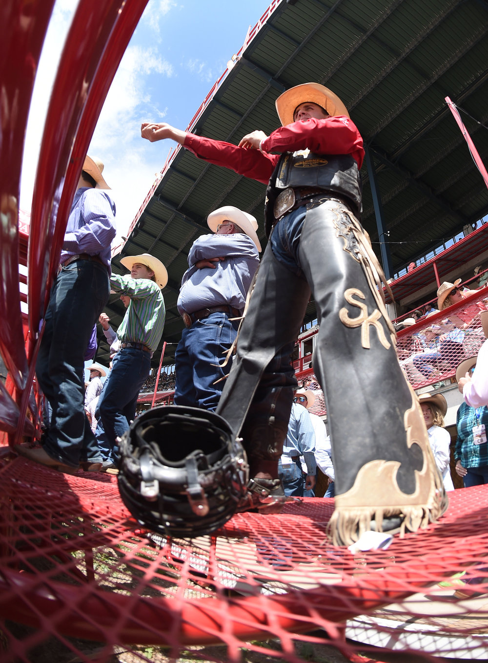 Bull riding champion Sage Kimzey, from Strong City, Oklahoma, prepares for his ride behind the bucking chutes during the 6th performance at the 122nd Cheyenne Frontier Days Rodeo at Frontier Park in Cheyenne, Wyoming Wednesday, July 25, 2018.