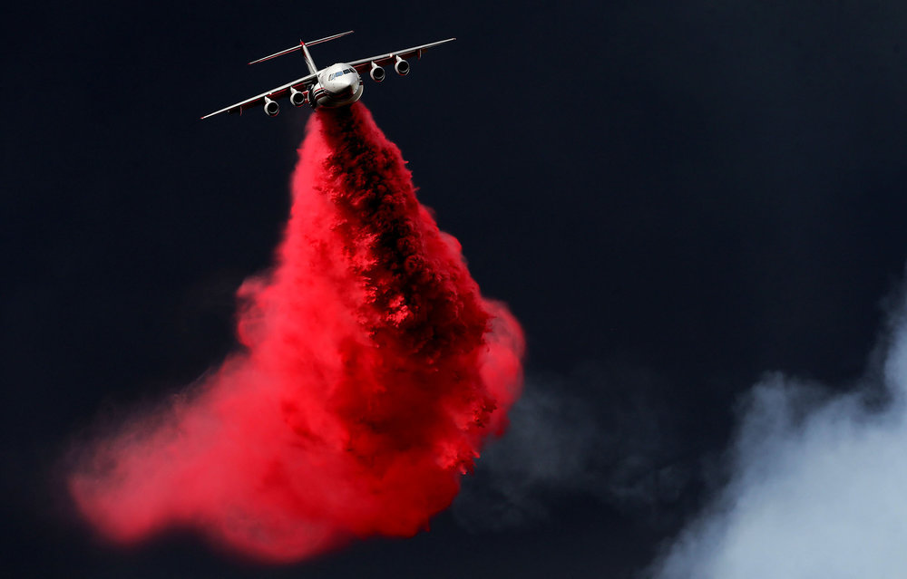 An air tanker makes a retardant drop on the Valley fire as it burns in the San Bernardino National Forest above Forest Falls on Friday, July 6, 2018.