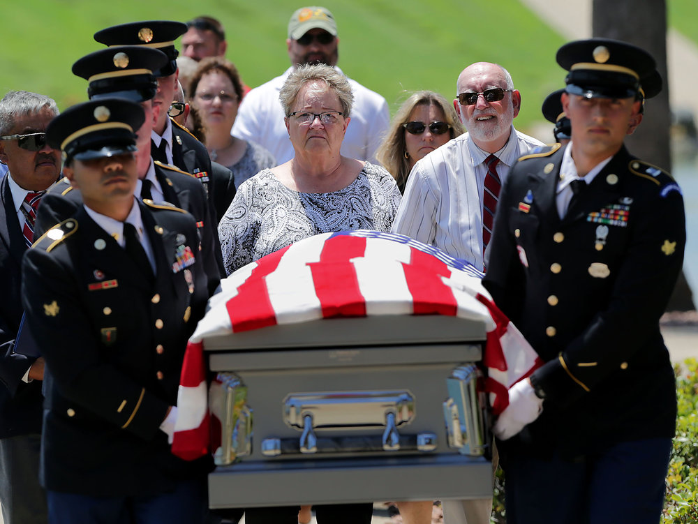Phil Rosenkrantz and wife Judy Rosenkrantz, center walk behind the casket of his uncle US Army Staff Sgt. David Rosenkrantz, 28, was killed Sept. 28, 1944, while on a mission to disrupt German defensive lines in the Netherlands during World War II.  His remains weren�t identified until 2017 and was laid to rest today at Riverside National Cemetery in Corona on Friday, July 20, 2018.