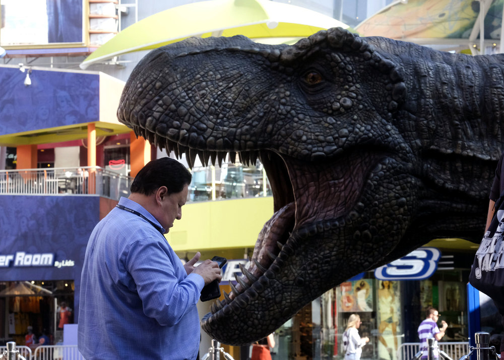 "A towering 13' tall by 36' wide and weighing 3 tones life-sized Tyrannosaurus rex, from the Jurassic Park movies, is displayed at Universal CityWalk in Los Angeles, the United States on June 21, 2018. Universal CityWalk is L.A.'s Dino-Destination, featuring: Advance Screenings of Jurassic World: Fallen Kingdom on 7 Universal Cinema Theatres, a Colossal 3-ton Tyrannosaurus rex towering 13' tall and 36' wide, a life-sized Gyrosphere original movie prop, as well as original costume displays. Plus, last chance to experience ""Jurassic Park—The Ride"" at Universal Studios Hollywood before it goes extinct on September 3."