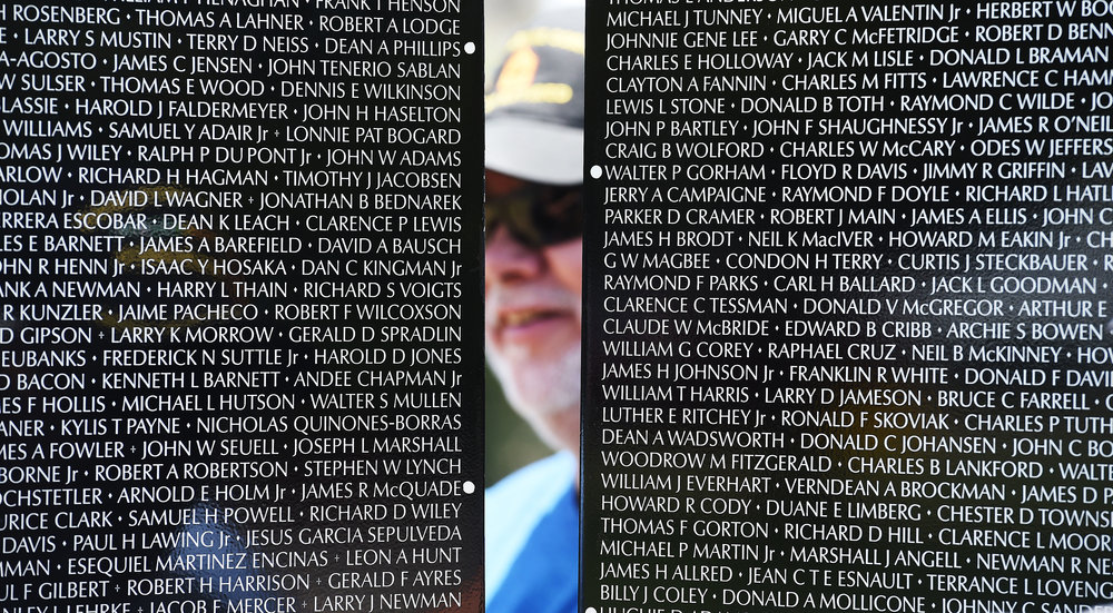 Vietnam Marine veteran Fred Corral, 65 from Rialto, helps install the first two panels of the Vietnam Moving Wall Thursday at Ayala Park in Bloomington. Volunteers, many being Vietnam veterans, helped construct the Vietnam Moving Wall in Ayala Park in Bloomington Thursday June 7, 2018. The wall, containing 58,318 names, with 132 being from San Bernardino County, will be on display 24-hours a day beginning Friday and lasting through Monday.