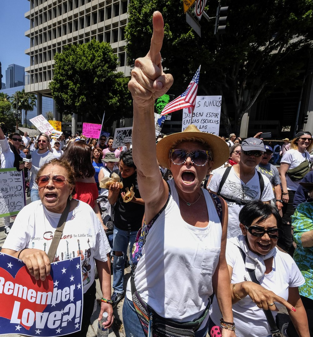 Anti-Trump demonstrators confront Trump supporters during a march against the separation of immigrant families, in Los Angeles on June 30, 2018. It's one of 600-plus marches to be held across the country to demand an end to separating and detaining families, and organizers are urging attendees to wear white in a show of unity.