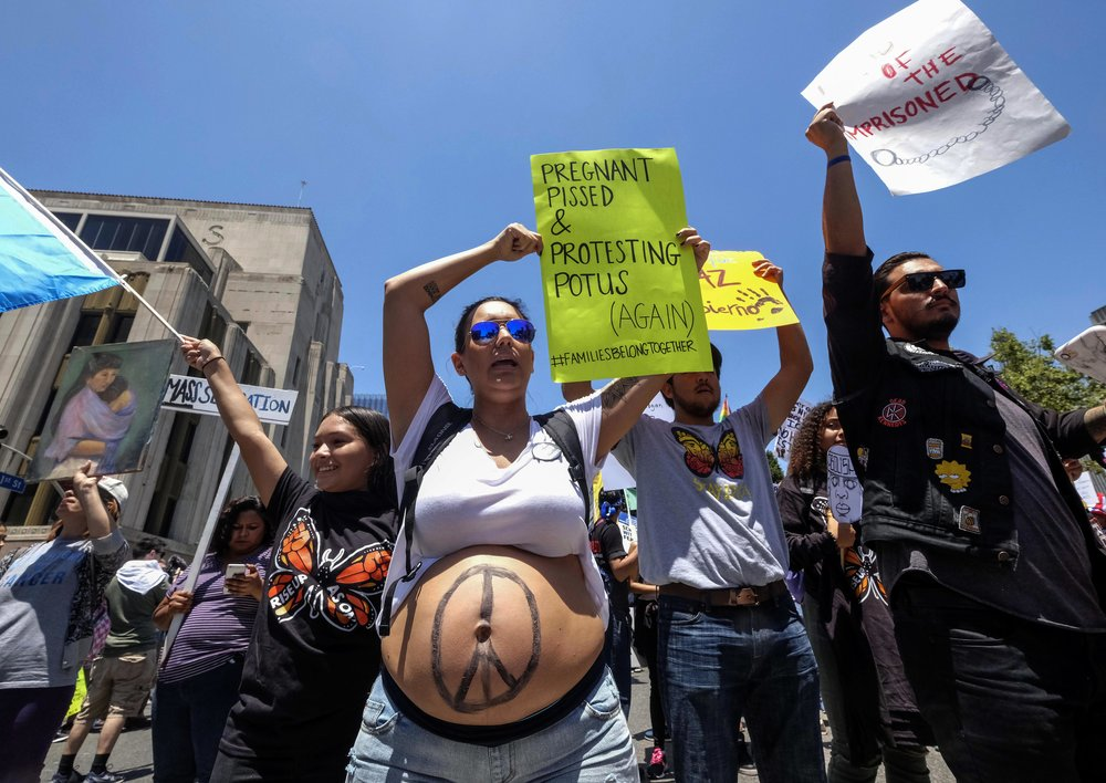 Demonstrators holding signs march against the separation of immigrant families in Los Angeles, the United States, on June 30, 2018. It's one of 600-plus marches to be held across the country to demand an end to separating and detaining families.