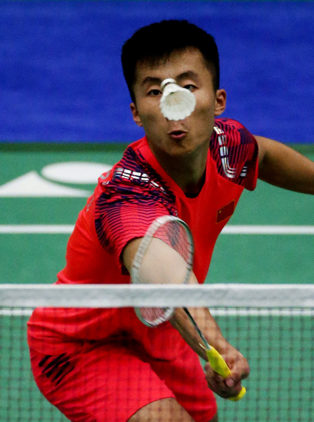 Lu Guangzu of China, returns a shot to Suppanyu Avihingsanon of Thai, in their men's singles during the second round of U.S. Open Badminton Championships on Thursday, June 14, 2018 in Los Angeles, the United States.  Lu won 2-1.