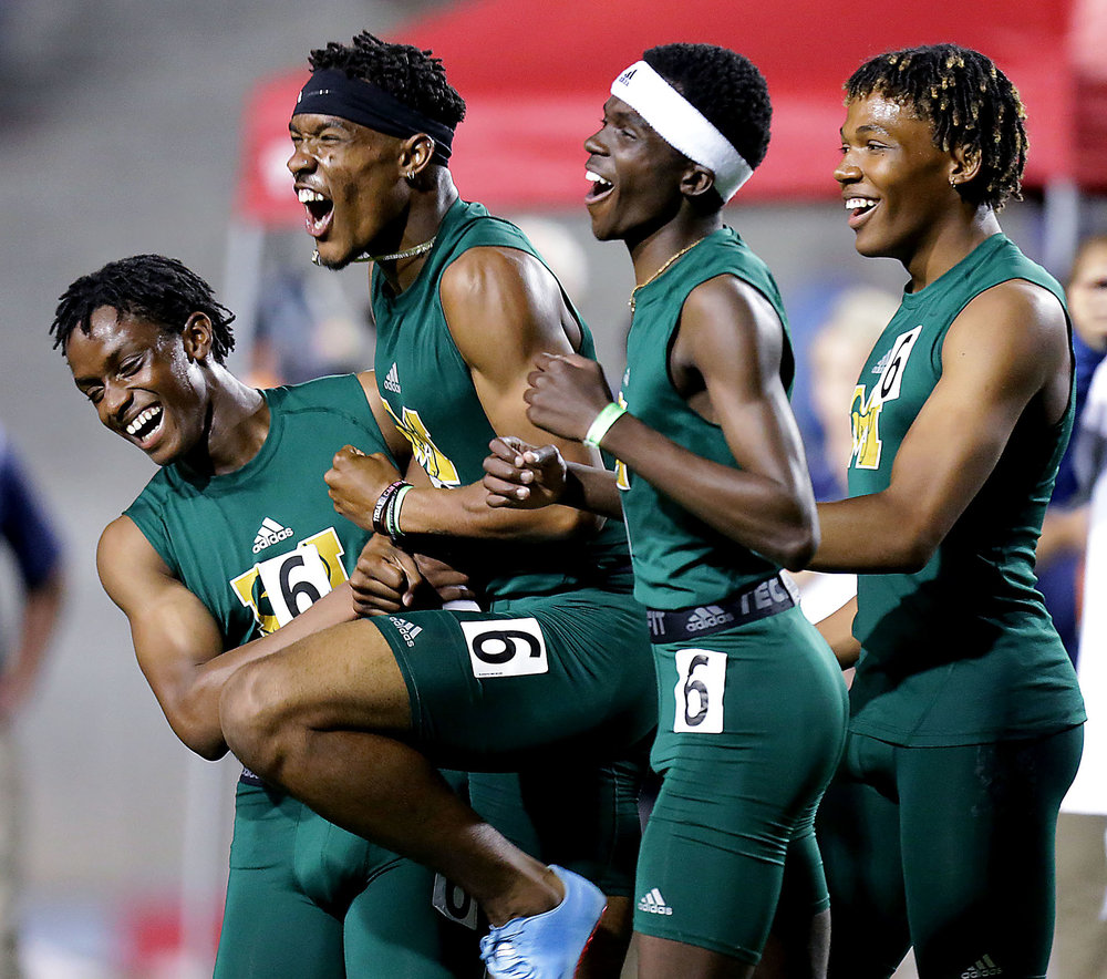 Murrieta Mesa 4X400 meter relay team celebrate after winning the start championship for the event and the Boys team championship of the 100th annal CIF State Track and Field Championships at Buchanan High Saturday in Clovis, Calif. June 2, 2018.