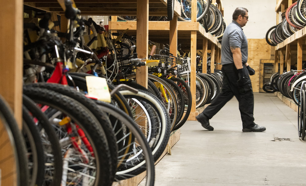 Long Beach Police Evidence Clerk Joe Jim�nez walks through the police warehouse Thursday in Long Beach August 2, 2018. The police have hundreds of recovered stolen bikes, but they can't get them back to their owners. Because without a serial number or a photo of the person on their bike, police cannot prove that person claiming the bike actually owns it. Councilwoman Suzie Price is trying to help with that by getting people in her district to register their bikes on the national bike registry list.