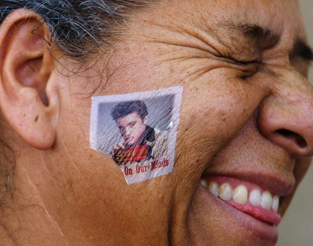 An Elvis Presley's fan with painted face participates in the 19th annual Elvis Festival to tribute the King of Rock N' Roll on Sunday August 26, 2018 in Garden Grove, California, the United States.