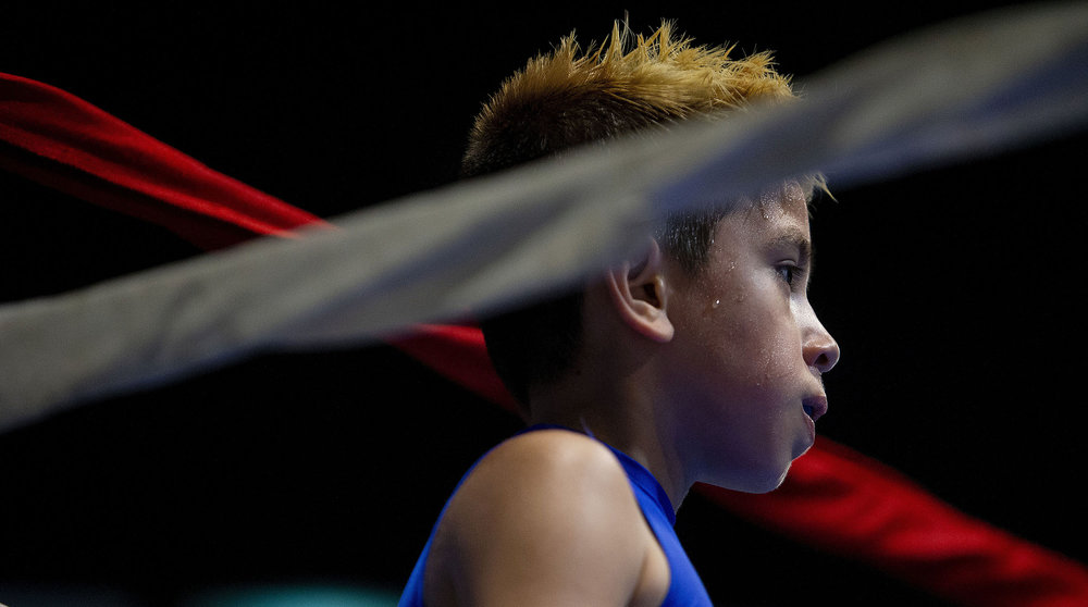 Compton Boxing's Alan Brizuela, 8, waits in the blue corner for the decision after boxing FTP Boxing's Adrian Herrera, 9, during the Future Olympics Champions at  Lake Perris Sports Pavilion in Perris on Saturday, August 18, 2018.
