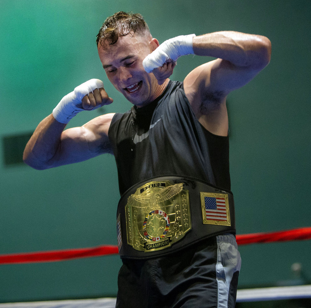 P-Town boxer Richard Lagunas dances in the ring after defeating First United Boxing's Bryant Meza during the Future Olympics Champions at  Lake Perris Sports Pavilion in Perris on Saturday, August 18, 2018.