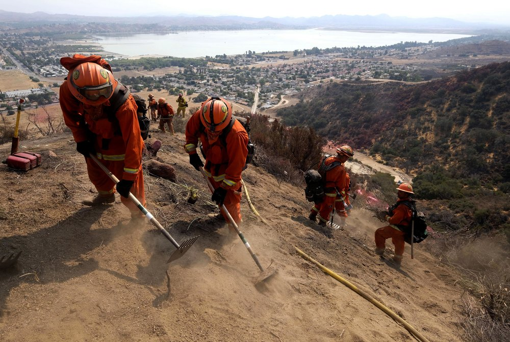 Hand crews work on the fire line at the Holy Fire in Lake Elsinore, California, southeast of Los Angeles, on August 11, 2018. The fire has burned 21,473 acres and was 29 percent contained as of 8:30 a.m. Saturday, according to the Cleveland National Forest.
