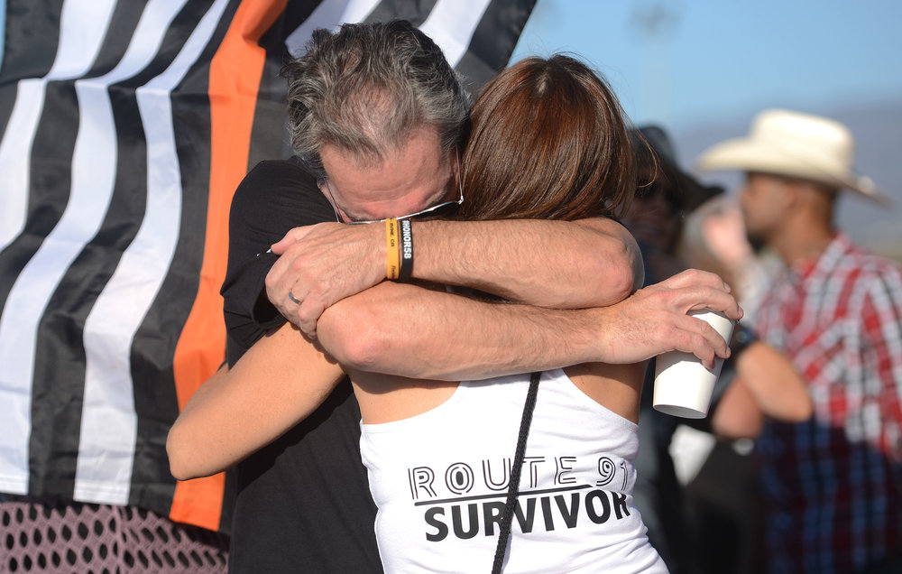 Patrick Murphy, from Burbank, tightly hugs his wife Genae, prior to Jason Aldean's performance Saturday, September 29, 2018 at FivePoint Amphitheatre in Irvine. Genae attended the Route 91 Harvest Festival show with a close friend when they became separated following the shooting. Murphy helped them by phone to unite hours later. Patrick and Renae married each other the week following the Las Vegas shooting. Approximately 500 Route 91 survivors attended the show. Aldean was on stage in Las Vegas last October 1 when a gun man shot and killed 58 concert goers at the Route 91 Harvest Festival.