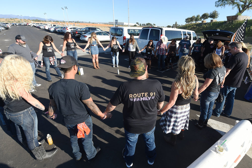 Route 91 Harvest Festival survivors hold hands during a moment of prayer with other survivors Saturday, September 29, 2018 at FivePoint Amphitheatre in Irvine prior to Jason Aldean's sold out performance. Approximately 500 Route 91 survivors attended the show. Aldean was on stage in Las Vegas last October 1 when a gun man shot and killed 58 concert goers at the Route 91 Harvest Festival.
