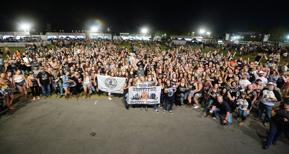Approximately 500 Route 91 Harvest Festival survivors pose for a group photo prior to country music artist Jason Aldean's performance Saturday, September 29, 2018 at FivePoint Amphitheatre in Irvine. Approximately 500 Route 91 survivors attended the show. Aldean was on stage in Las Vegas last October 1 when a gun man shot and killed 58 concert goers at the Route 91 Harvest Festival.