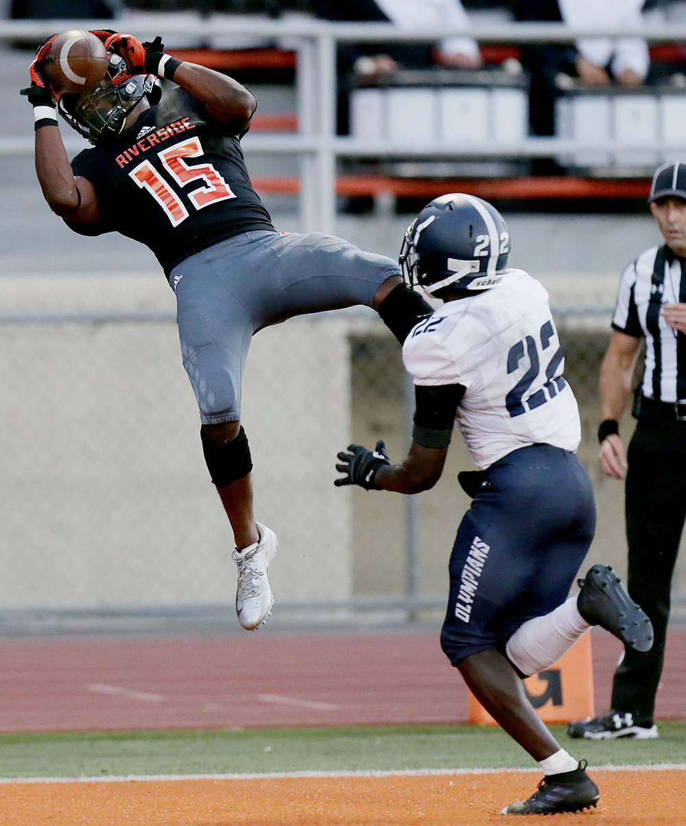 Riverside City College wide receiver Tyrone Marshall #15 makes the touch down catch behind San Diego Mesa's  Jacob Denson #22 in the first half of the game at Wheelock Field  in Riverside on Saturday, September 29, 2018.