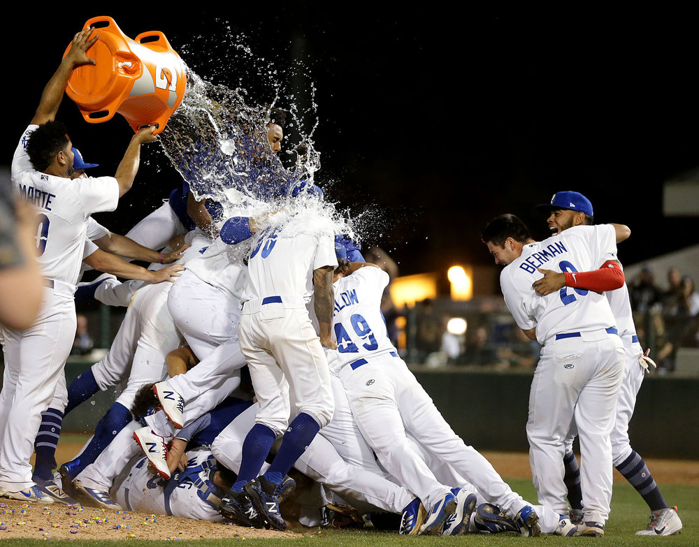 Rancho Cucamonga Quakes catcher Hamlet Marte #50 celebrate douses teammates with water after defeating Visalia Rawhide's 9-1 to win the California League Finals at LoanMart Field in Rancho Cucamonga on Friday, September 14, 2018.