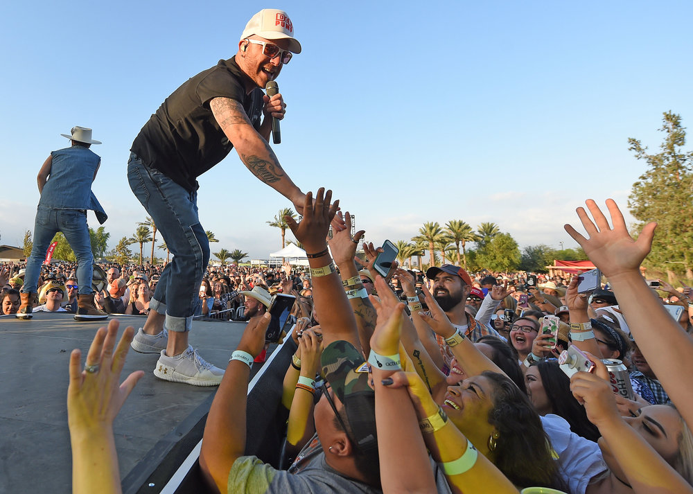 Locash's Chris Lucas (right) and Preston Brust (left) perform during the Boots In The Park country music festival Saturday, October 6, 2018 at the BackYard at SilverLakes in Norco. Billy Currington, LOCASH and others performed at the event.