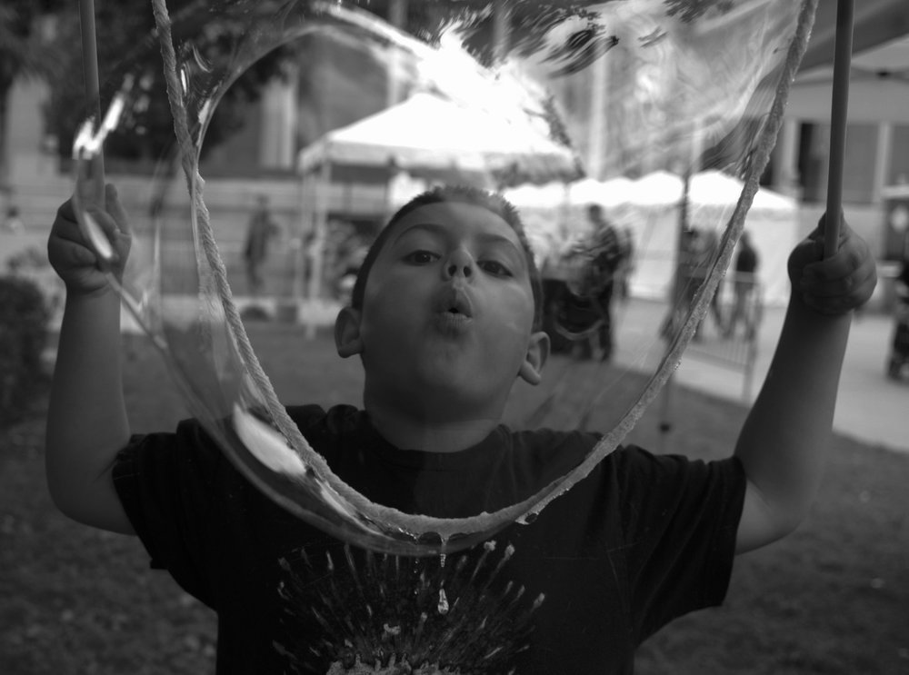 A boy blows bubbles during CSUN 60th Anniversary Grand Reunion at Cal State Northridge, Nov. 13, 2018.
