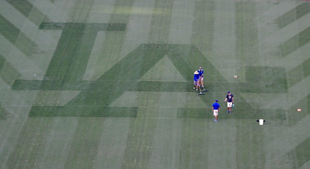 Los Angeles Dodgers grounds crew prepare the field prior to game three of the World Series at Dodger Stadium on Thursday, October 25, 2018 in Los Angeles, California.
