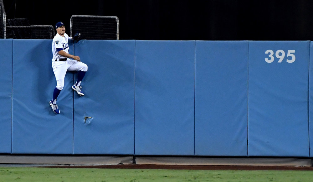 Enrique Hernandez of the Los Angeles Dodgers goes up the wall, but can't reach a Steve Pearce ( not pictured) of the Boston Red Sox solo home run in the eighth inning of game five of the World Series at Dodger Stadium on Sunday, October 28, 2018 in Los Angeles, California.