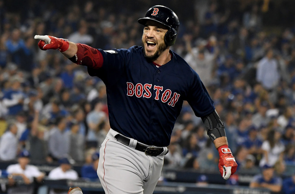 The Boston Red Sox' Steve Pearce points to his teammates as he celebrates hitting a solo home run against the Los Angeles Dodgers in the eighth inning of game five of the World Series at Dodger Stadium on Sunday, October 28, 2018 in Los Angeles, California.